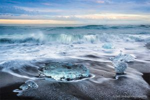 Crashing Wave and Icebergs on Jokulsarlon Beach Iceland.jpg