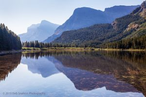 Fishercap Lake reflections in smoke Glacier National Park Montana USA.jpg
