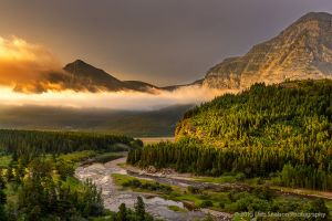 Sunrise smoke and fog Reynolds Creek Fire 2015 Many Glacier area Glacier National Park Montana USA.jpg