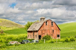 Red barn with discarded cars Palouse Washington.jpg