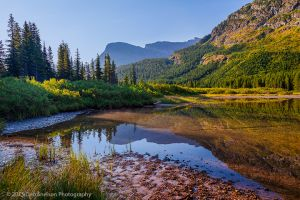 Fishercap Lake with foothill of Mt Grinnell Glacier National Park Montana-c74.jpg