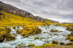 Fossalar River glacial melt flowing through lava field Iceland.jpg